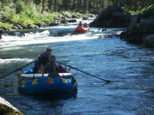 Self bailing white water rafts